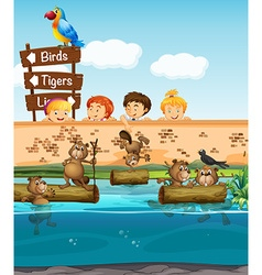 Children looking at beavers in the zoo vector