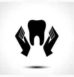 Hand holding a tooth icon vector