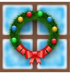 Frosted window with Christmas wreath vector image