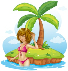 A lady wearing a pink bikini at the beach vector image
