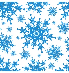 White seamless pattern with blue snowflakes vector
