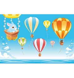 Hot air balloons in the sky on the sea with bunny vector