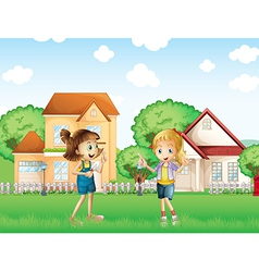 Two young ladies playing in the ground in front of vector image vector image