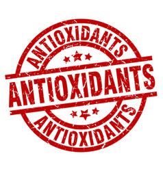 Antioxidants round red grunge stamp vector