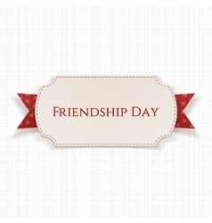 Friendship day label on red ribbon vector