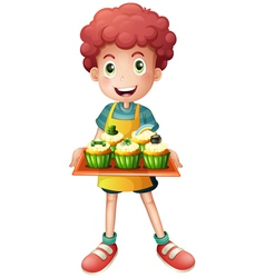 A young baker holding a tray with cupcakes vector image