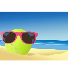 Tennis ball on the beach sand vector