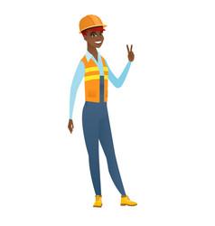 African-american builder showing victory gesture vector