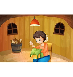 A woman sewing inside a wooden house vector