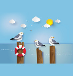 Seagull standing on a wooden post vector