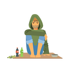 Young homeless man character sitting on the street vector