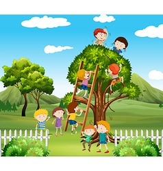 Kids climbing up tree in the park vector image
