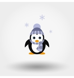 Penguin in a knitted cap vector