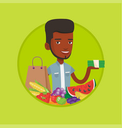 Young man standing at the table with shopping bag vector