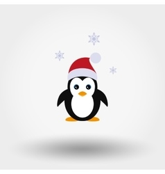 Penguin in a Santa Claus hat vector image