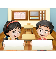 Two smiling teenagers with empty signages vector image