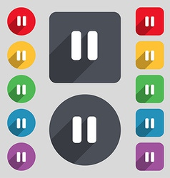 Pause icon sign a set of 12 colored buttons and a vector