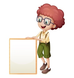 A young boy holding an empty frame vector