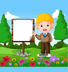 happy boy with empty signboard vector image