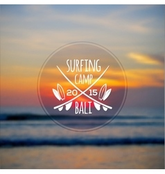 White surfing camp logo on blurred ocean sunset vector