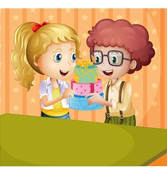 A girl and a boy holding gifts vector image