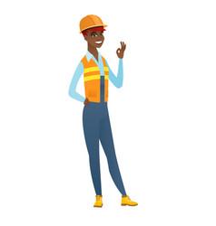 Smiling builder showing ok sign vector
