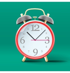 Red vintage alarm clock on green background vector image