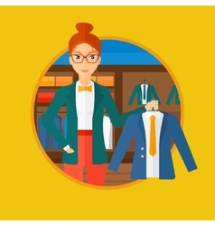 Woman holding jacket in clothing store vector