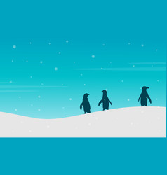 Landscape of penguin on hill silhouette vector