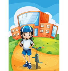 A female biker standing in front of a school vector