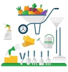 wheelbarrow and garden equipment vector image
