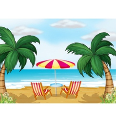 A view of the beach with a beach umbrella and vector