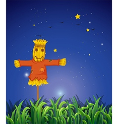 A field with a scarecrow vector