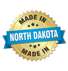 Made in north dakota gold badge with blue ribbon vector