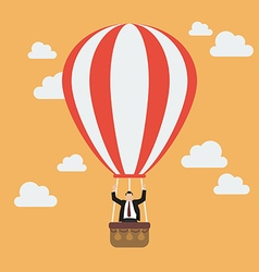 Businessman celebrating in hot air balloon vector
