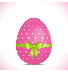 Pink polka dot easter egg with green ribbon vector