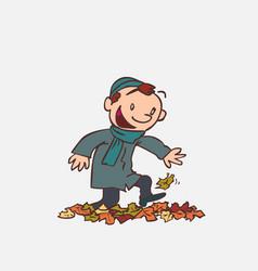 child having fun treading autumn leaves vector image