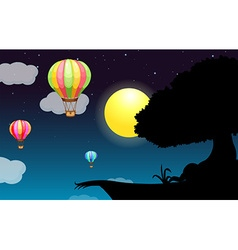 Silhouette of a cliff with full moon vector