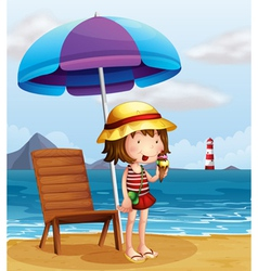 A young woman eating an icecream at the beach vector image