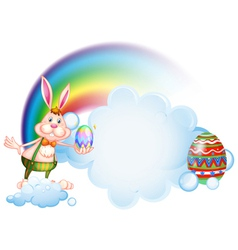 A bunny holding an egg near the rainbow vector image