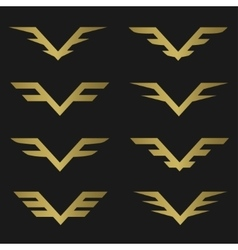 Golden wings emblem vector