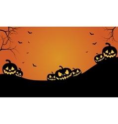 Halloween pumpkins and bat at afternoon vector