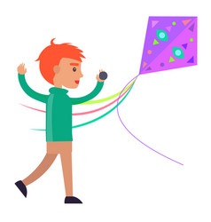Redhead boy plays with colorful kite vector