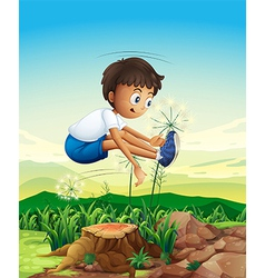 A boy jumping above the stump vector image