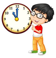 Asian boy looking at big clock vector