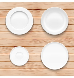 White plate set on wooden background kitchen vector