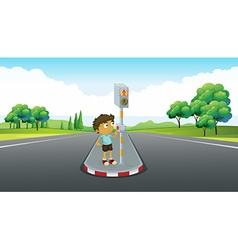 Boy using signal to cross the road vector