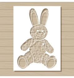 Stencil template of bunny on wooden background vector