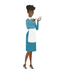 African cleaner holding a mobile phone vector
