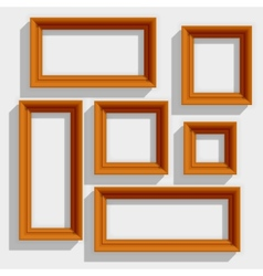 Empty wooden brown picture frames isolated on the vector